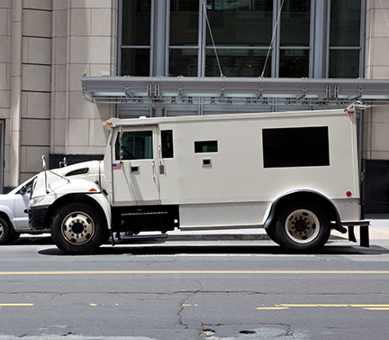 Armored car parked in front of office