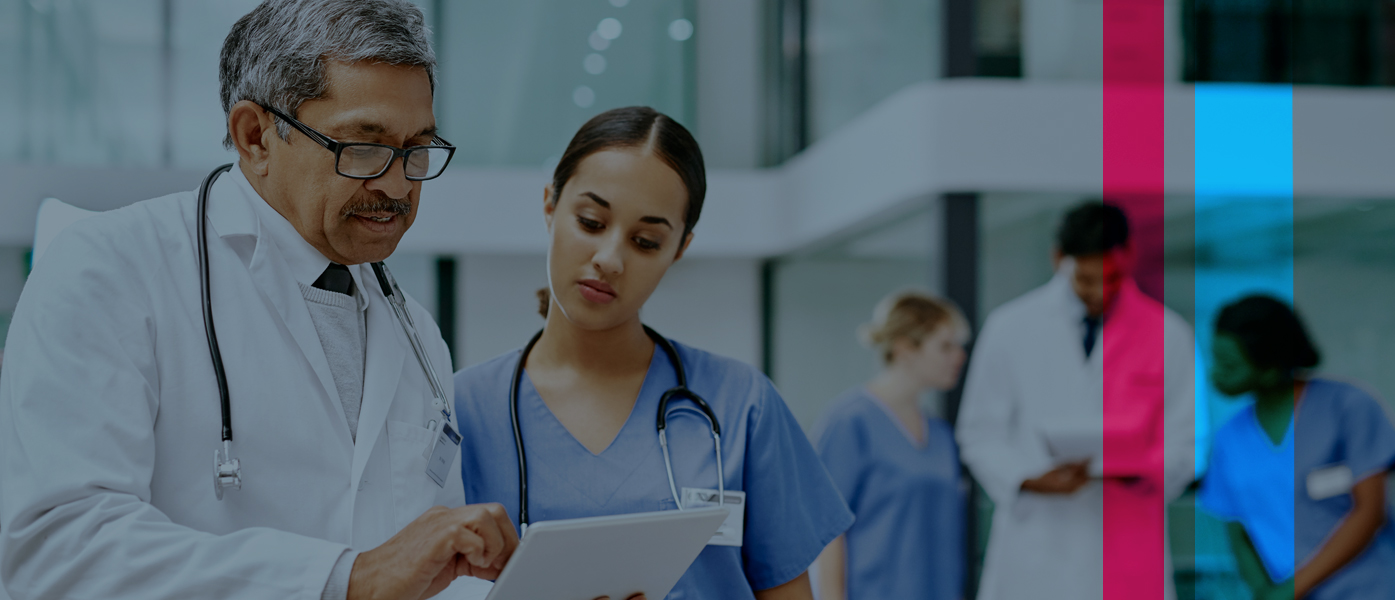 doctor and nurse reviewing mobile device