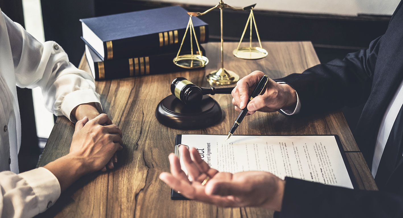 Lawyer's office with contract on table with gavel