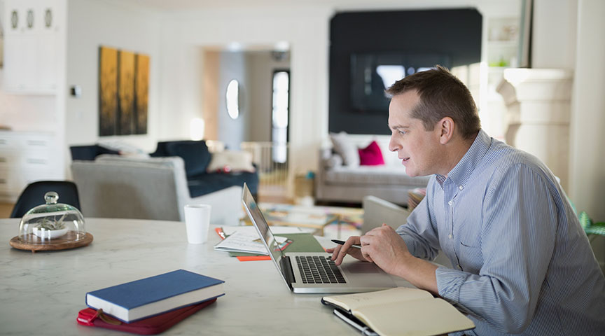 Man on laptop working from home