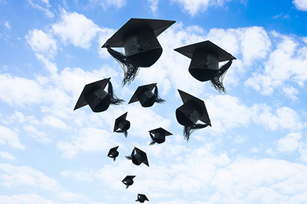 Graduate Caps Flying in Sky