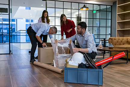 Diverse group moving into new office